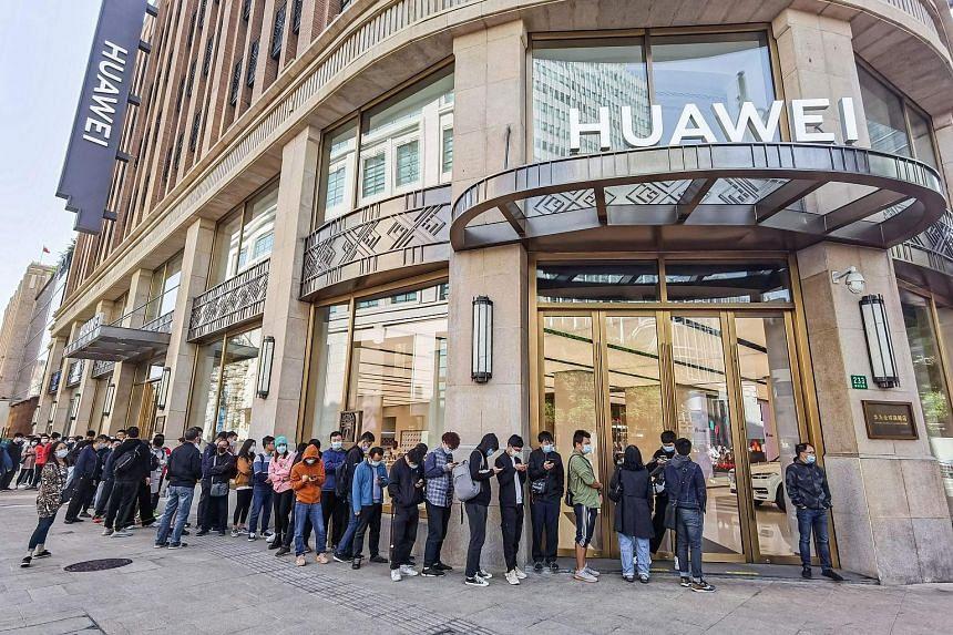 The queue at Huawei's store in Shanghai last October for the Mate 40 phone series. Chip shortages this year could affect the supply of gadgets.