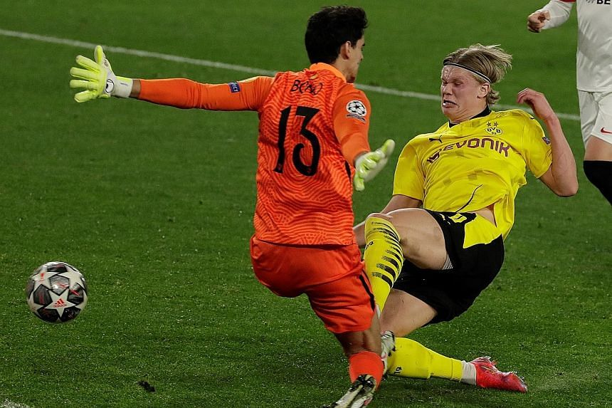 Erling Haaland scoring past Bono to give Dortmund the lead against Sevilla. His double has boosted his tally to 18 goals in 13 Champions League matches.