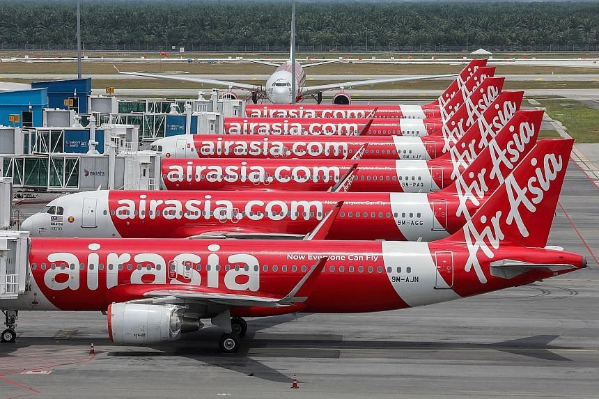 AirAsia planes parked at Kuala Lumpur airport last April, amid the Covid-19 pandemic's disruptions to air travel. Last July, the airline's auditors filed a report with Malaysia's stock exchange saying that the budget carrier may not survive. It has b