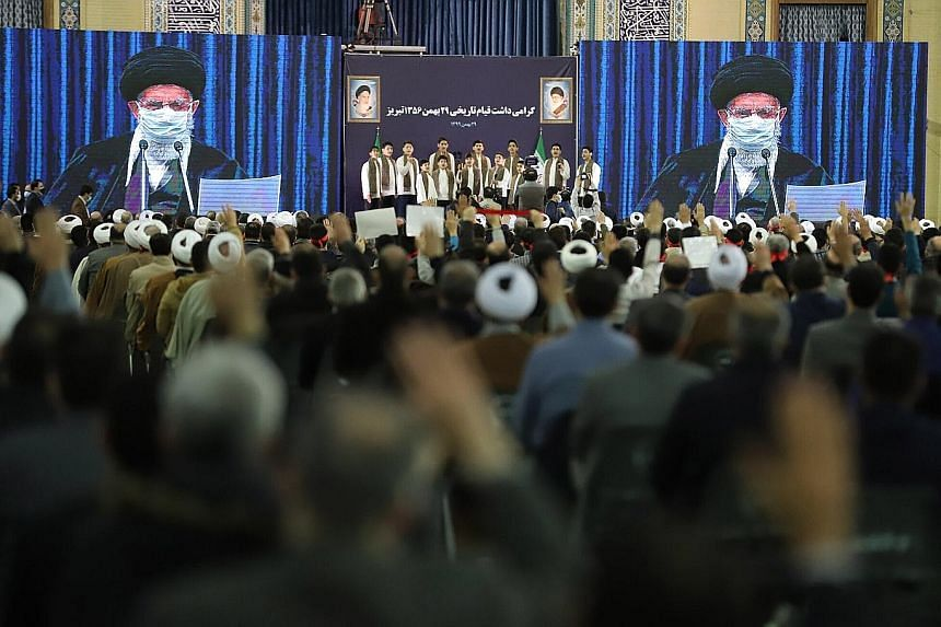 """Iranian Supreme Leader Ali Khamenei speaking to a crowd via videoconference in Teheran on Wednesday. He has demanded """"action, not words"""" from the US if it wants to revive Iran's 2015 nuclear deal with world powers."""