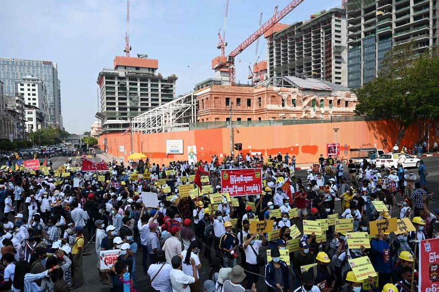 Myanmar's railway staff members take part in a protest against the military coup in Yangon on Feb 19, 2021.