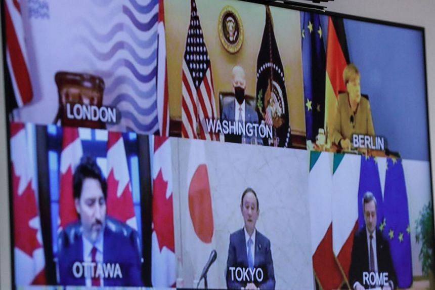 G-7 head of states are seen on a screen at the European Council headquarters in Brussels on Feb 19, 2021.