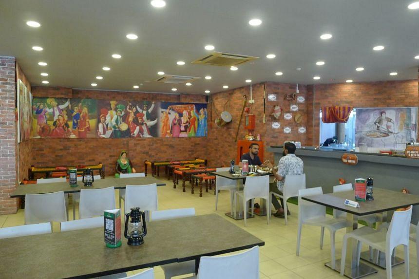 The interior of the Bhai Da Dhaba restaurant which serves Punjabi cuisine.