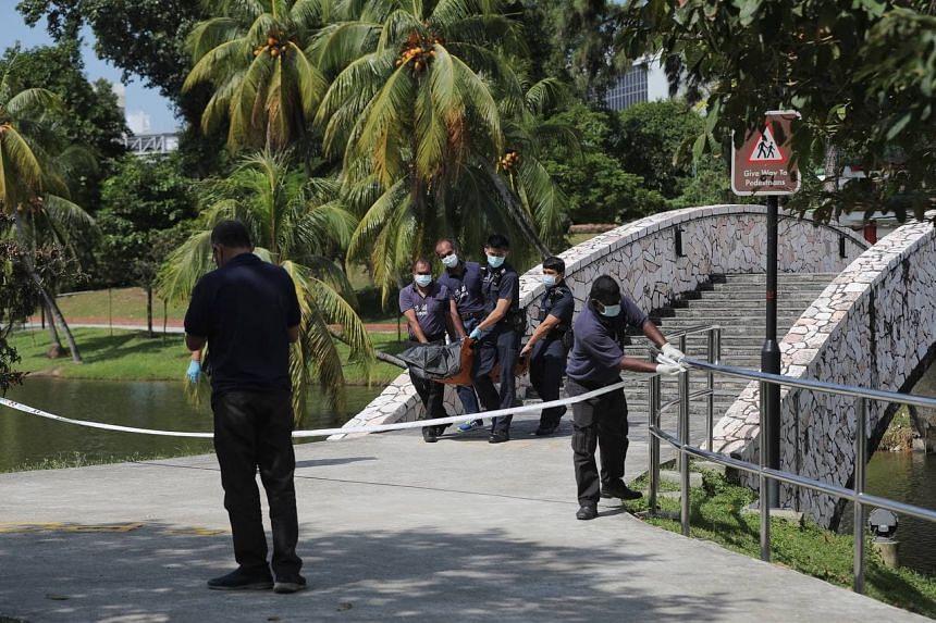 Ms Loke Xiao Li's body being taken away from the scene in Marsiling Park on Feb 18, 2021.