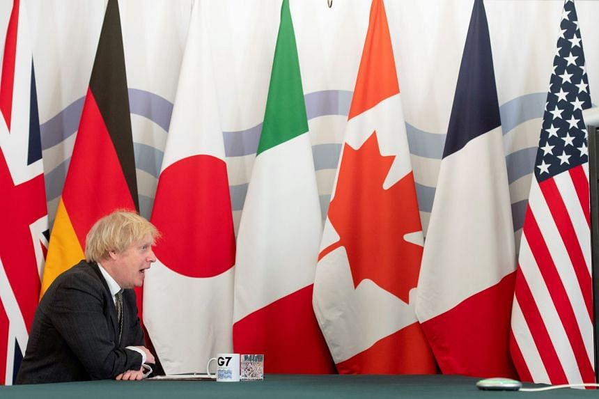 Britain's Prime Minister Boris Johnson hosts an online G-7 Summit on Feb 19, 2021, against a backdrop of members' flags.