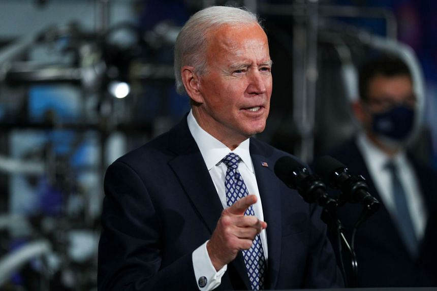 Biden speaks at Pfizer's vaccine manufacturing site on Feb 19, 2021, in Portage, Michigan.