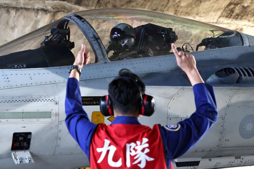 A pilot prepares to take off at an Air Force base in Tainan, Taiwan.
