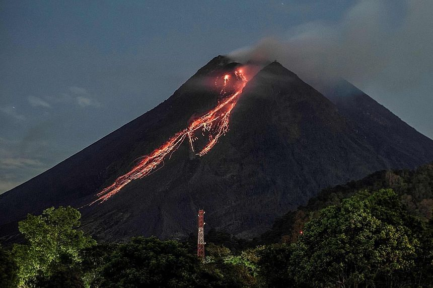 Red-hot lava flowing down from the crater of Mount Merapi as seen from Kaliurang, in Yogyakarta, yesterday. Residents near the volcano, which has been erupting sporadically since January, have been warned to avoid the area within a 5km radius of the