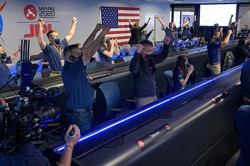 The area where the rover landed as seen in a Nasa photo. PHOTO: EPA-EFE Members of Nasa's Perseverance rover team cheering and applauding in mission control at the Jet Propulsion Laboratory near Los Angeles on Thursday, after receiving confirmation t