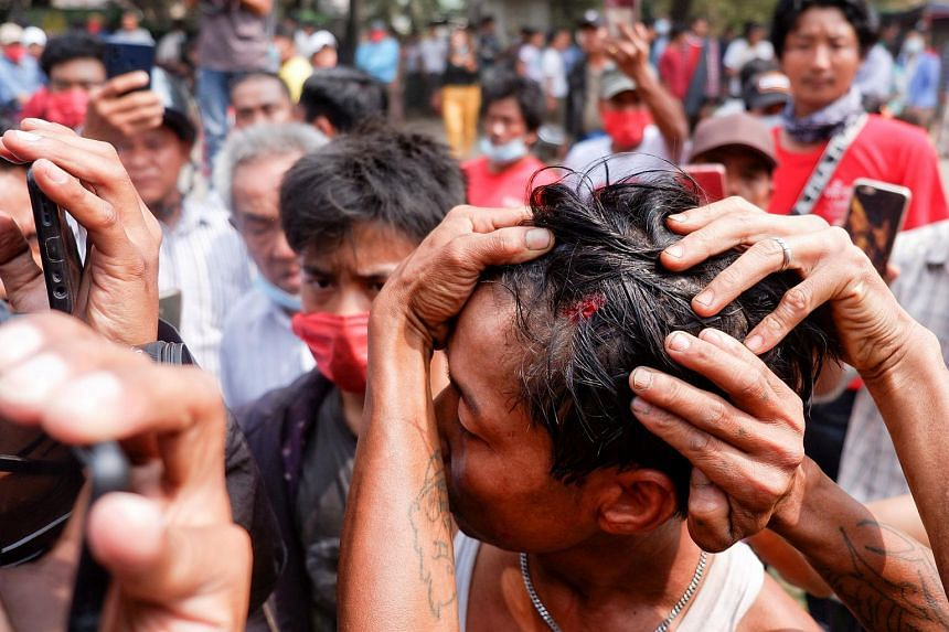 A man injured during protests in Mandalay on Feb 20, 2021.