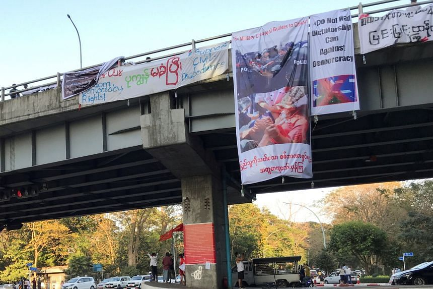 A 15-metre-long banner with artwork depicting the moment she was shot was hung off a bridge in Yangon.