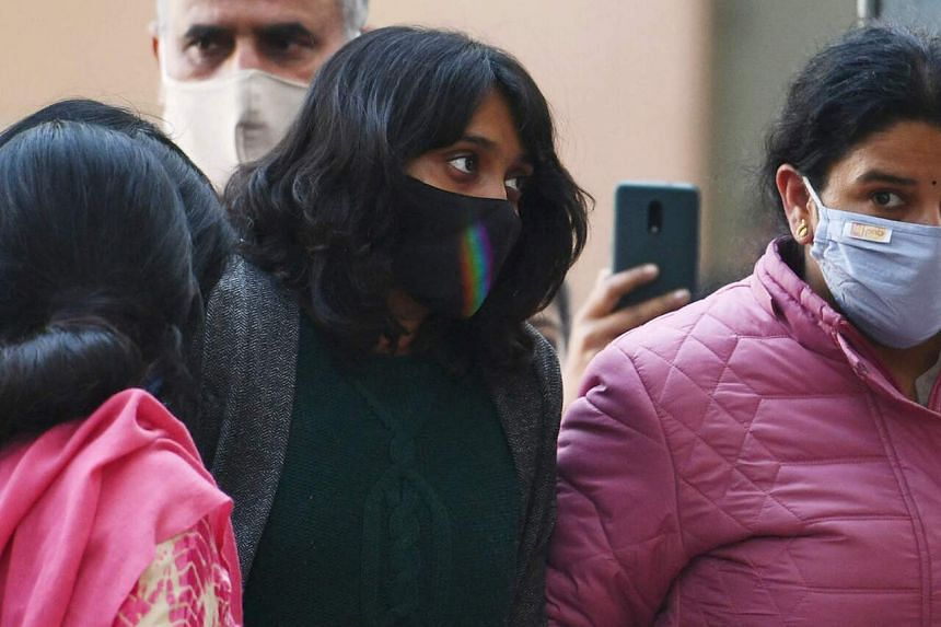 """Climate activist Disha Ravi (centre) who they accuse of sedition for her alleged role in the creation of an online """"toolkit""""."""
