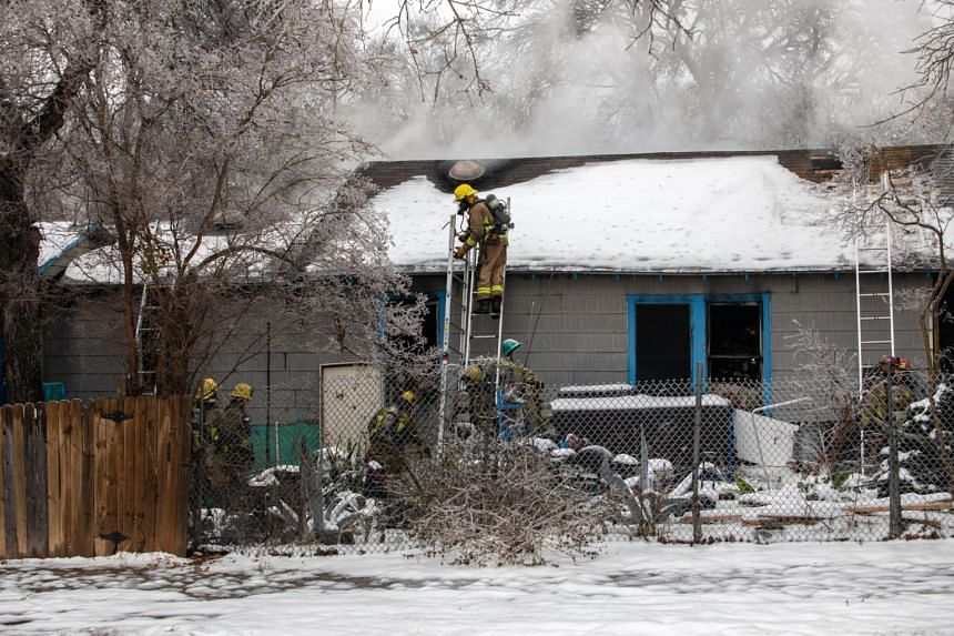Firefighters on the scene of a structure fire in Austin, Texas, on Feb 17, 2021.
