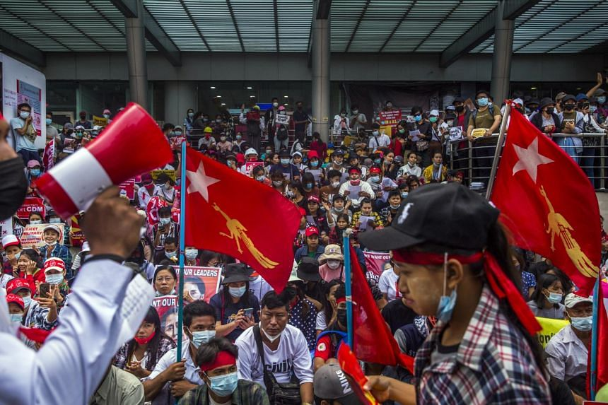 People protest the recent military coup in Yangon, on Feb 19, 2021.