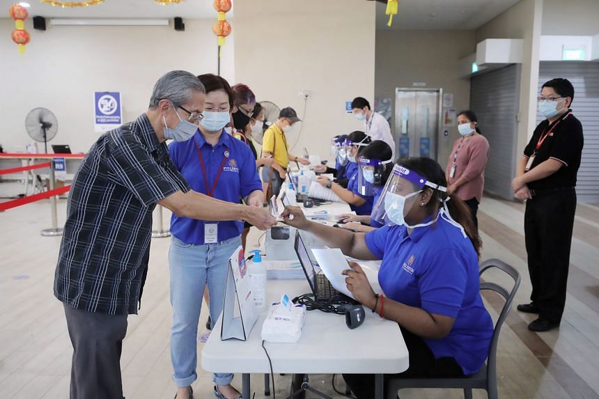 Above and left: People turning up to receive their Covid-19 vaccination jabs at the Jalan Besar Community Club yesterday. Having more than one approved vaccine provides the country some sort of insurance as Singapore will not need to rely on a single