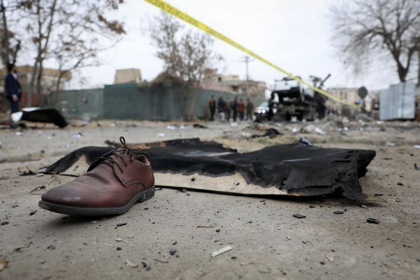Victims' belongings are seen on the ground at the scene of a bomb blast in Kabul, Afghanistan, Feb 20, 2021.