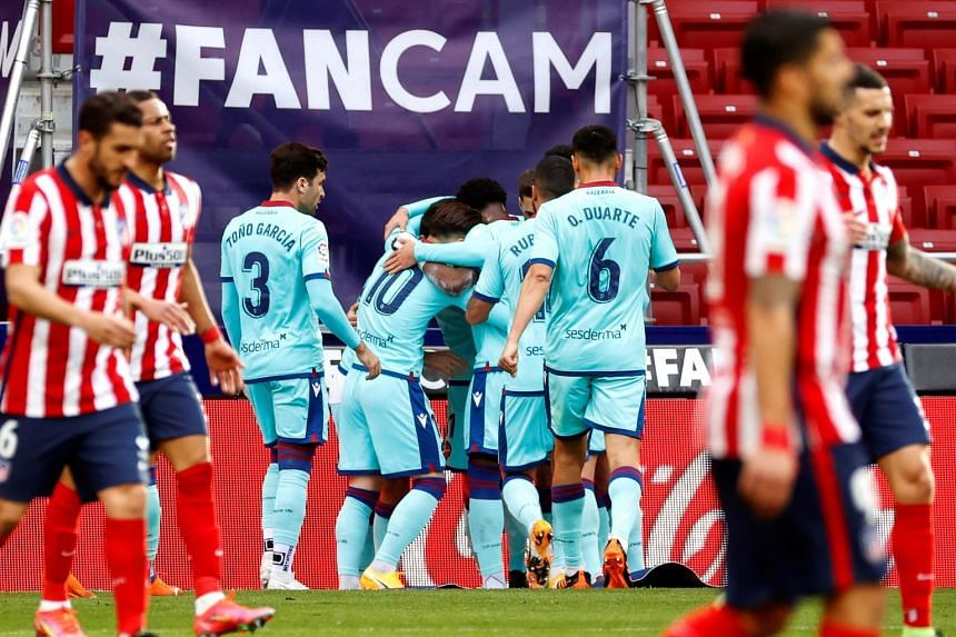 Levante players celebrate their 1-0 lead during the match.