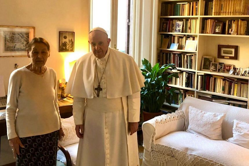 Pope Francis and poetess and Holocaust survivor, Edith Brick, pose for photographs in Rome.