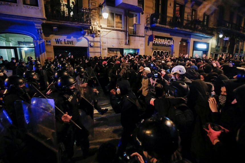 Demonstrators clash with police in Barcelona, Feb 20, 2021.