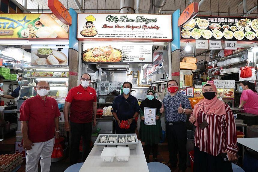 Right: (From left) West Coast Drive Merchants' Association chairman Bernard Thia; Minister for Communications and Information S. Iswaran; Mr Abdul Rauf Abdul Hamid of award-winning stall Mr Dum Briyani (No. 78) and his wife Marita Mohd Salleh; IBF pr