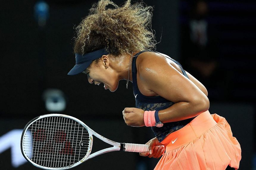 Japan's Naomi Osaka celebrating after winning a point against Jennifer Brady in yesterday's Australian Open final. She won 69 points compared to the American's 54.