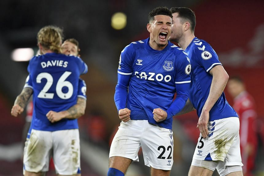 Everton's Ben Godfrey (centre) and his teammates celebrate after winning the match against Liverpool on Feb 20, 2021.
