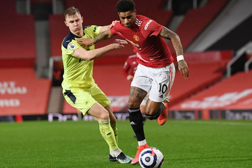 Newcastle United's Emil Krafth in action with Manchester United's Marcus Rashford on Feb 21, 2021.