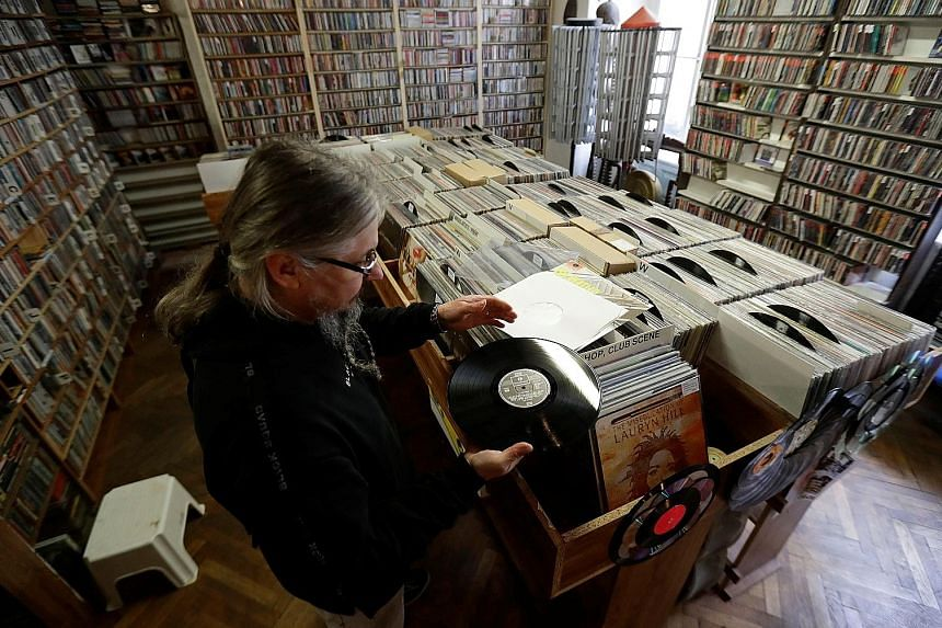 Music store owner Petr Rakosnik sorting vinyl records in his shop in Prague, Czech Republic. The pandemic has sparked a vinyl revival despite the popularity of digital options.