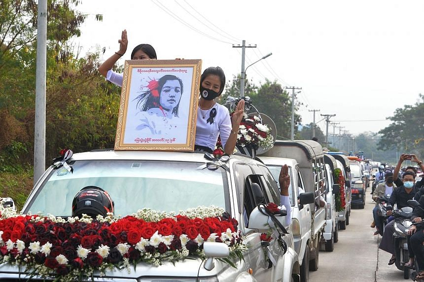 A portrait of young protester Mya Thwate Thwate Khaing placed at the head of a convoy for her funeral in Naypyitaw yesterday. The 20-year-old died on Friday after being shot during a rally against the Feb 1 military coup. The military media said the