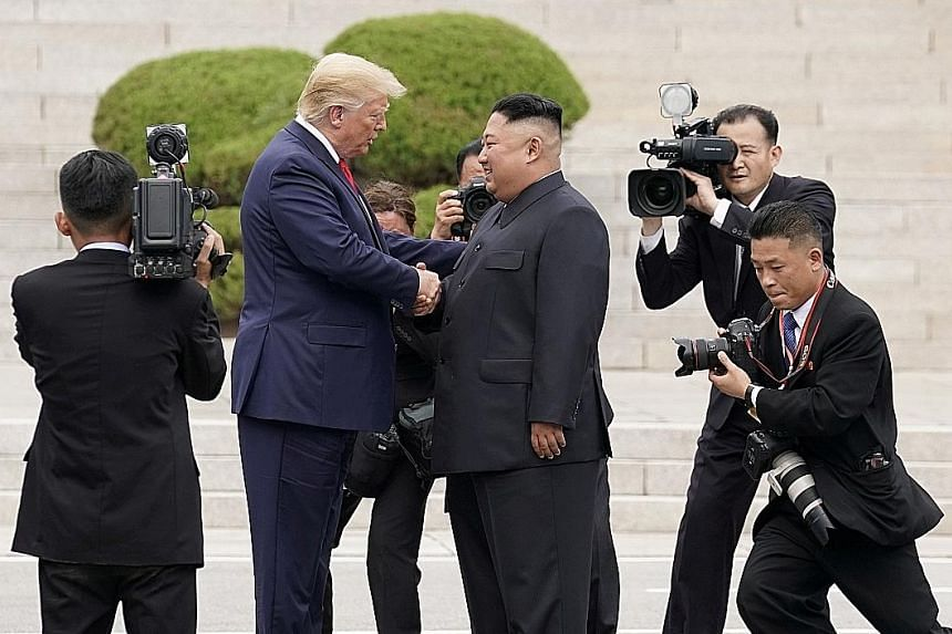 Left: A military parade in Pyongyang on Jan 14 to celebrate the 8th Congress of the Workers' Party of Korea, with what appeared to be submarine-launched ballistic missiles on display. After three high-profile summits with the US, North Korea is actua