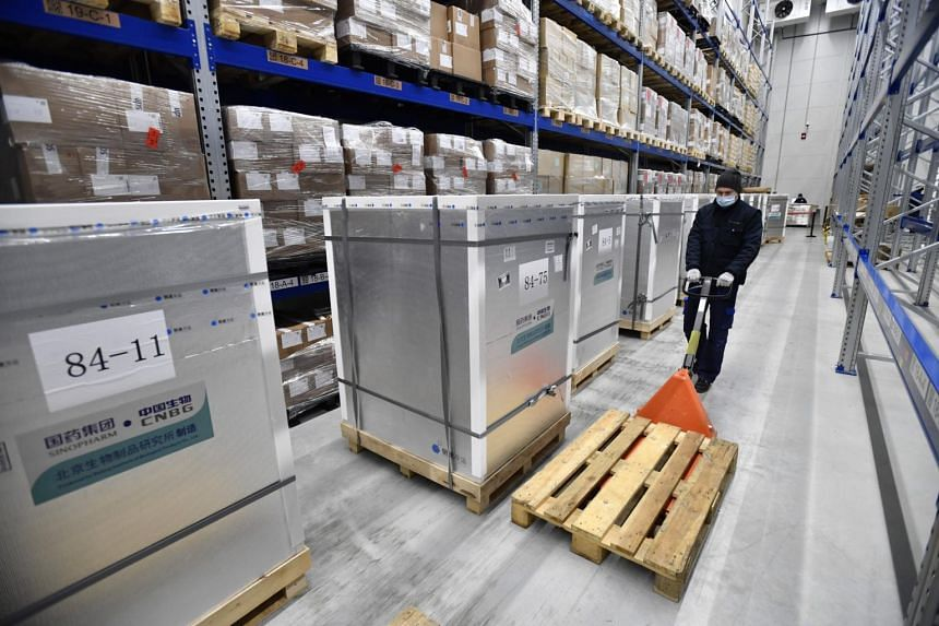 Containers with the Covid-19 produced by China's Sinopharm are stored in the logistics centre of Hungarian pharmaceutical wholesaler Hungaropharma in Budapest, Hungary, on Feb 16, 2021.