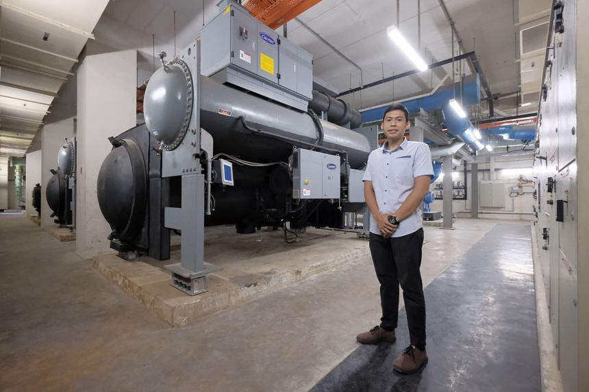 Home Team Academy's building and infrastructure specialist Zulfadhli Fahim Suratman with the energy-efficient chillers behind him.