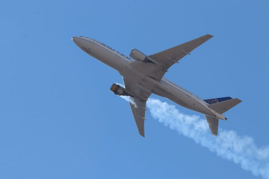 United Airlines flight 328 with an engine on fire, flying over Denver, Colorado, on Feb 20, 2021.