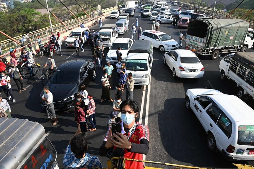 People block a bridge with their cars during a demonstration against the military coup in Yangon on Feb 17, 2021.