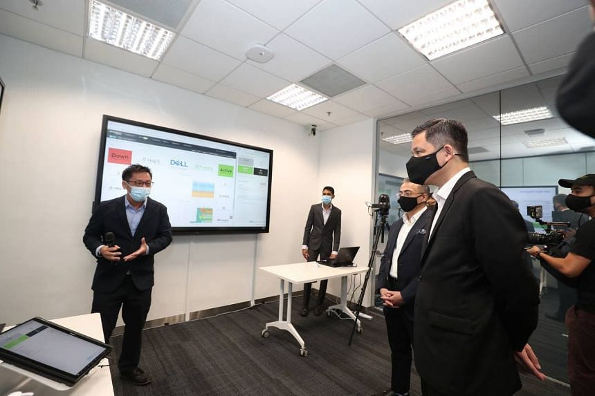 Minister for Trade and Industry Chan Chun Sing (right) at the launch of Dell Technologies' Global Innovation Hub at International Business Park on Feb 22, 2021. The hub will focus on making advances in digital transformation and experiences.