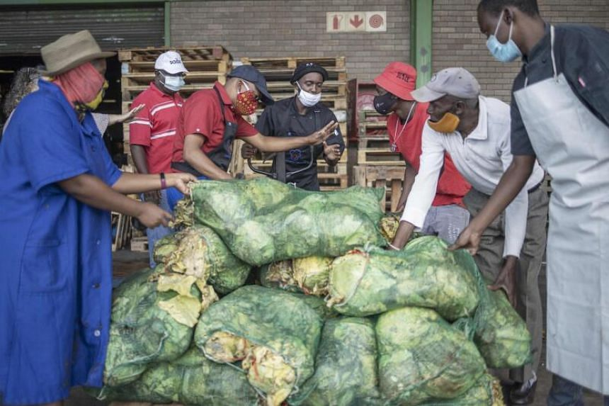 Volunteers loading a pallet of discarded cabbages at the City Deep Fresh Product Market in Johannesburg, on Feb 15, 2021.