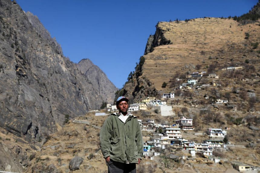 Kundan Singh poses near his home in Raini village, in the northern state of Uttarakhand, India, on Feb 11, 2021.