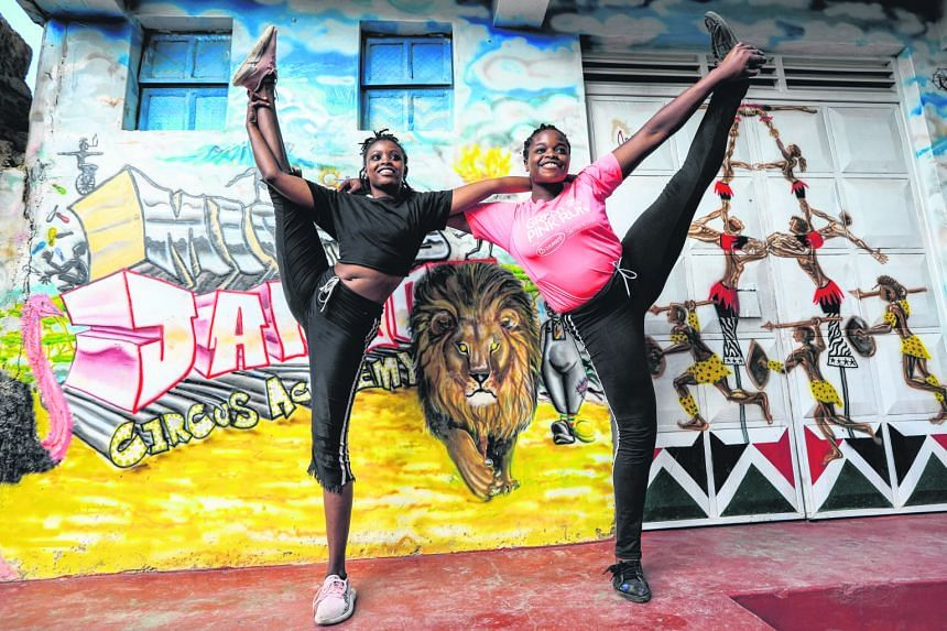UPLIFTING SPIRITS:(Above, far left and left) Kenyan acrobatic members of the Mighty Jambo Circus Academy during their training routine at the school in Nairobi, Kenya. The academy has resumed its daily exercise regimen after months of closure since t
