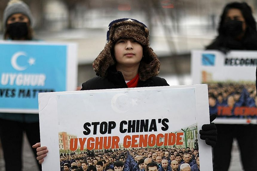 Protesters outside the Canadian Embassy in Washington last Friday. They were taking part in a rally to encourage Canada and other countries as they consider labelling China's treatment of its Uighur population and Muslim minorities as genocide.