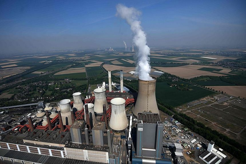 A coal-fired power station in Niederaussem, Germany. Fossil fuels are readily available and do their job very effectively, but their prices do not reflect the damage they do to people or the environment, Mr Bill Gates says. Energy innovation is thus