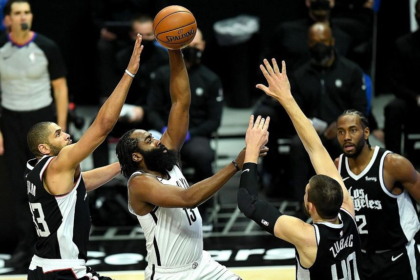 Nets guard James Harden driving to the basket amid the attentions of the Clippers' Nicolas Batum and Ivica Zubac. Harden led Brooklyn to a fifth straight win on the road, underlining their status as one of the East's leading teams.