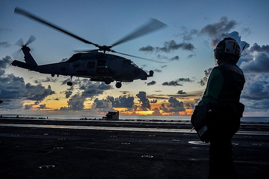 A helicopter taking off from aircraft carrier USS Ronald Reagan in the South China Sea last year. If a major crisis in the South China Sea or Taiwan Strait punctuates the US-China competition, decision-makers should exercise great caution in relying