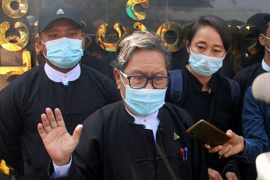 Lawyer Khin Maung Zaw (centre) has been tasked with defending Ms Aung San Suu Kyi from a pair of obscure charges.