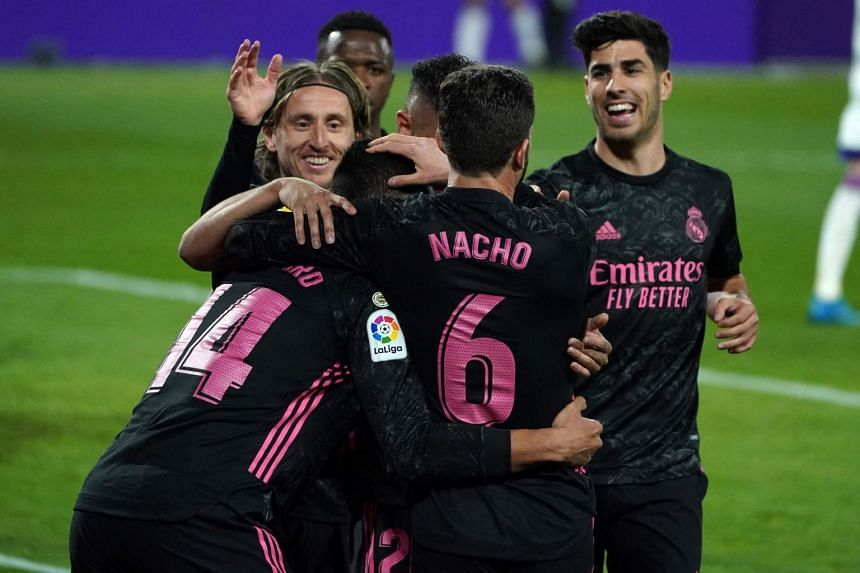 Real Madrid's players celebrate during the football match between Real Valladolid FC and Real Madrid CF in Valladolid, Spain, on Feb 20, 2021.
