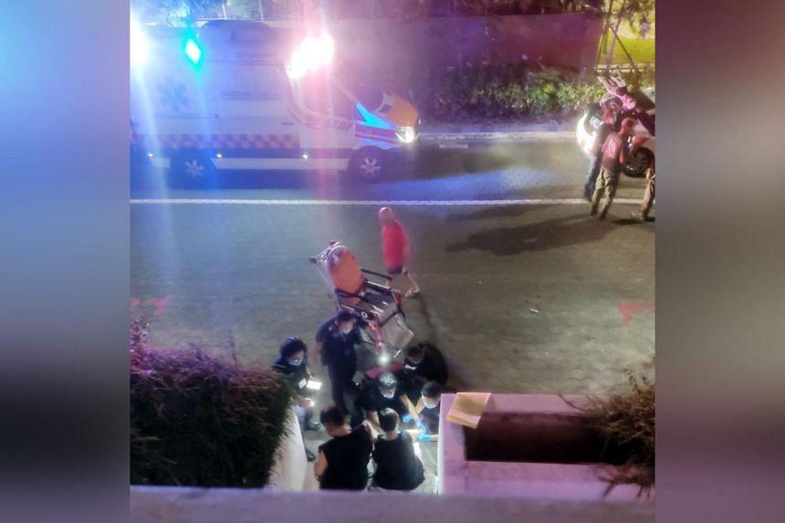 Paramedics at the scene of the attack at 310A Punggol Walk.