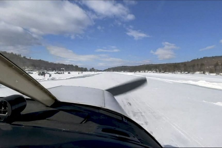Pilot Scott Bahan in a Piper Cherokee small plane taxis to the runway in Alton, New Hampshire on Lake Winnipesaukee, on Feb 22, 2021.