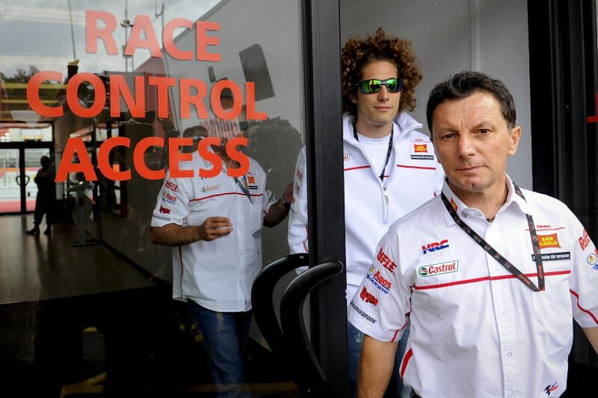 Italian rider Marco Simoncelli (left) and team manager Italian Fausto Gresini at the Catalunya Grand Prix in Montmelo, Barcelona, on June 2, 2011.