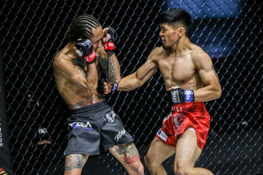 Lito Adiwang and Namiki Kawahara (left) in their One: Unbreakable strawweight bout at the Singapore Indoor Stadium, on Jan 22, 2021.