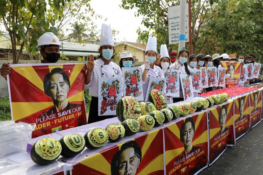 "Carved watermelons with the words ""Justice for Myanmar"" and portraits of detained leader Aung San Suu Kyi are displayed in Mandalay, Myanmar, on Feb 19, 2021."