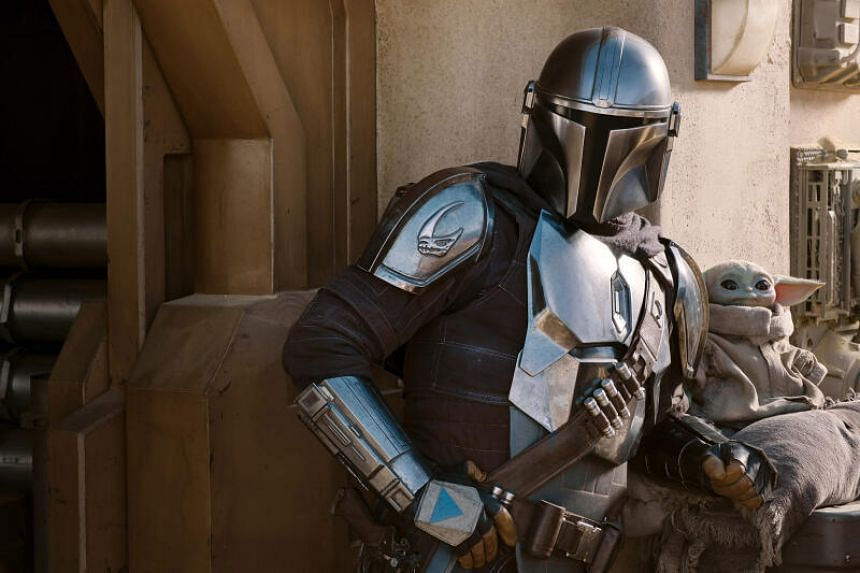 A still from The Mandalorian starring Pedro Pascal.